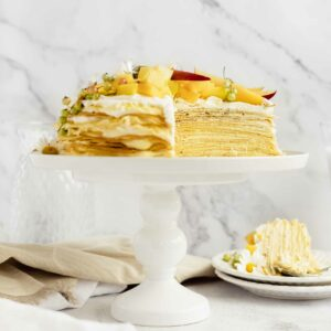 cut crepe cake with ombre filling