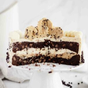 a look inside the cake with brownie layers and cookie dough on top